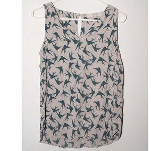 Tan sleeveless shirt with teal birds